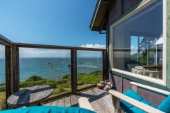 Turtle Rocks Inn Suite with bed, couch, chairs and oceanview
