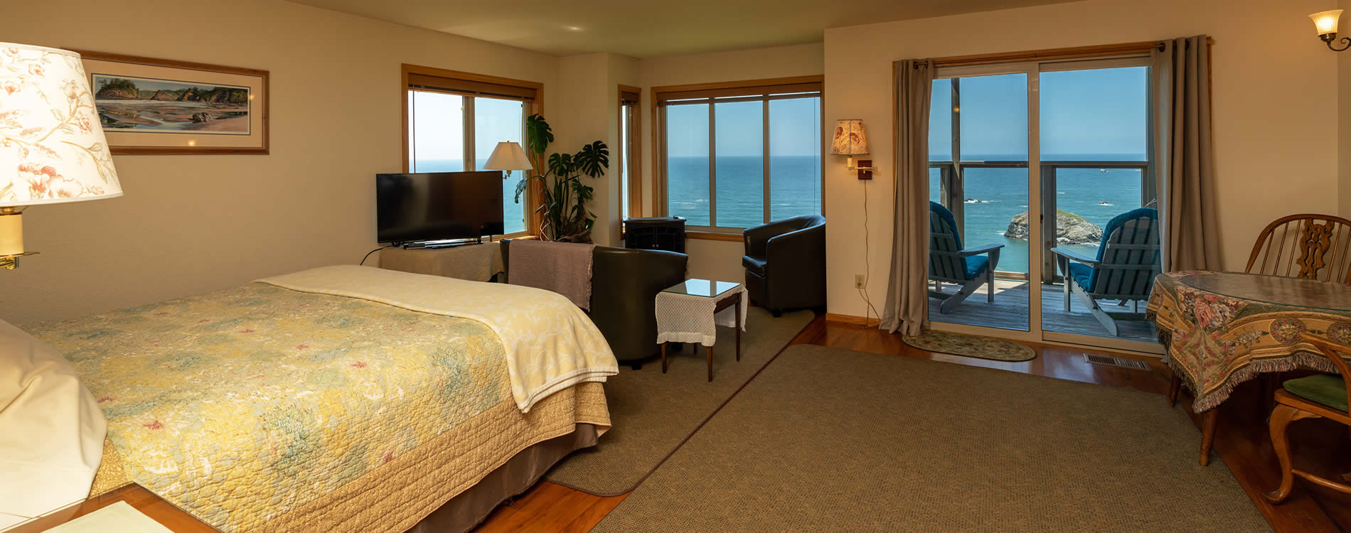 guest room with bed and couch northern california coast bed and breakfast - oceanview lodging in trinidad ca